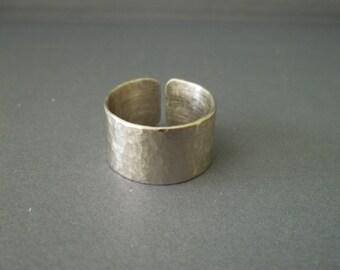 Handmade  hammered  silver cuff ring .
