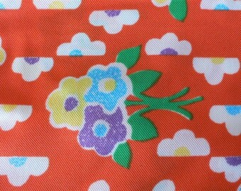vintage fabric polyester orange background floral print from Diz Has Neat Stuff