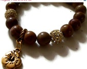 20% OFF Woodgrain - Brown Gemstone Stretch Bracelet with Gold CZ Pave Balls, Gold Stardust and Gold Hibiscus Flower Charm