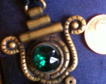 Emerald green Brass Pendant Necklace Ornate scroll Vintage pendent with emerald green faceted stone  on Black Silk