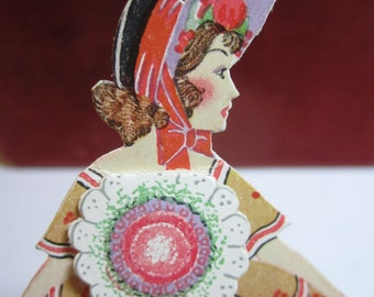 Wonderful early 1920's unused die cut 2 piece place card pretty lady in elaborate dress and bonnet with removable bouquet P.F.volland
