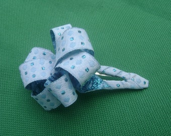 """1/2"""" ribbon wrapped snap clip with loopy ribbon accent"""