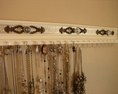 """Reserved for Rosanna 19 hooks for necklaces, space for 19 pairs of earrings lots of storage at 26""""long w/ c9!hmpagne embossed backgroundMNM"""