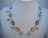 Colored Beadweaving Daisies on a Pearl Glass Seed Bead chain with Plastic Leaves