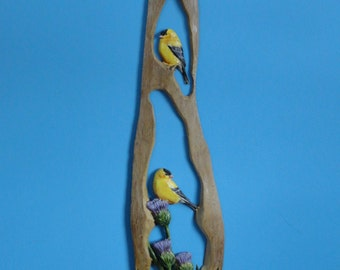Carved and painted gold finches and thistle on driftwood