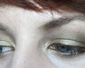 Archer eyeshadow- shimmery beige-gold with taupe undertones