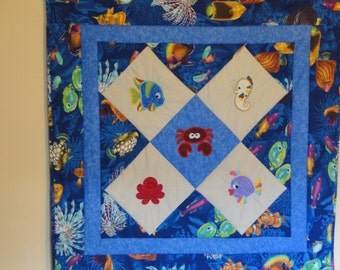 Appliqued Sea World Baby Quilt,  Blues abound with Embroidered Appliques.  Bright Happy Quilt