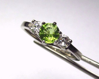 Wonderful Peridot Round in an Accented Sterling Silver Ring