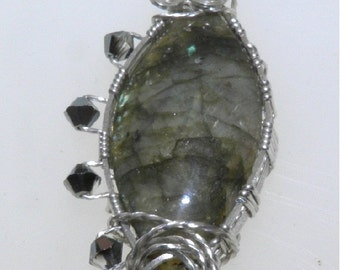 Beautiful Labradorite cabachon adorned with swavroski crystals...