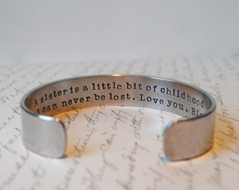 A Sister is a Little Bit of Childhood that can Never Be Lost Secret Message Hand Stamped Bracelet- Personalized Bracelet