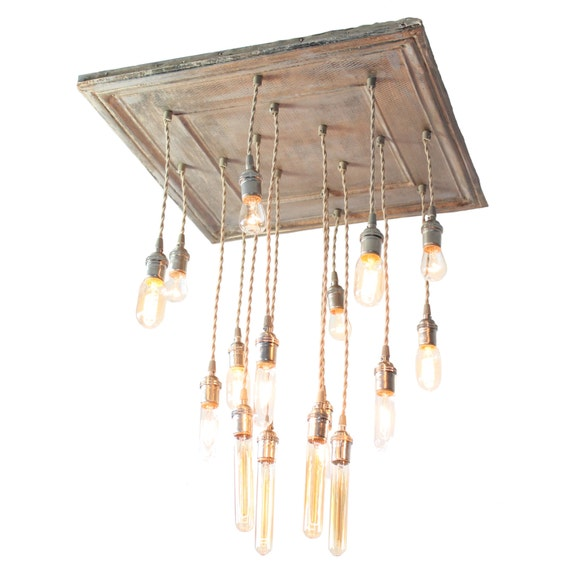 Salvaged barn tin repurposed into chandelier with various edison bulbs