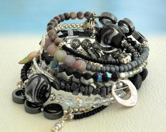 Dressy...  Memory wire beaded bracelet... black, grey, silver beaded 8 rounds bracelet. Original OceanBead style.