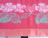 Vintage camp blanket with flower border on top and bottom damage in one corner