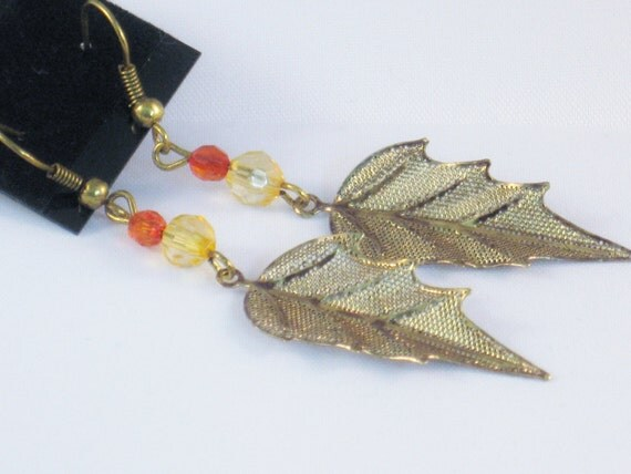 Dangling Earrings with a Gold leaf