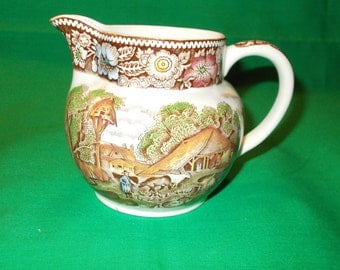 "One (1), 3 1/2"", 8 oz Creamer, from W R Midwinter, Ltd, in the Rural England-Brown Multicolor Pattern."