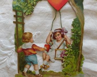 Vintage1926 Girl on Tree Swing with Boy Valentines Day Card Antique Love Romantic Hearts Garden Children Ephemera