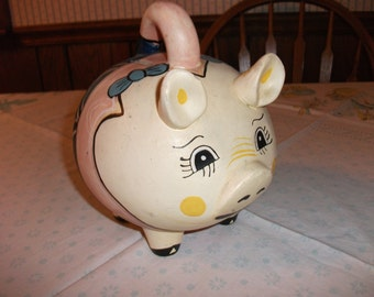 Vintage Piggy Bank, with handle and hand painted features.