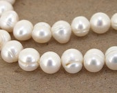 Luster Full One Strand----- Luster Pure Oval Baroque  White  Freshwater Pearl----9mmx8mm----about 46Pieces----15inch strand