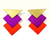 Three Arrow Post Earrings in Gold, Neon Purple, and Orange.