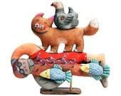 surf lifesaver rescuing a cat and a bird - soft sculpture