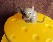 Mouse on cheese covered dish
