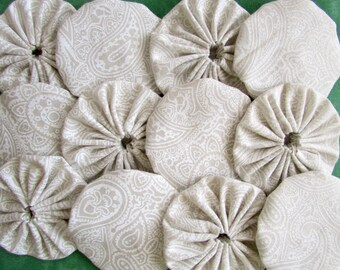 yo yos 100 1 1/2  inch Cream on cream fabric
