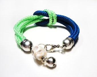 Climb rope bracelet with skull and bell charms