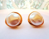 Vintage Monet gold and white pierced earrings