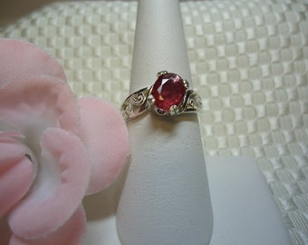 Oval Cut Ruby Offset Ring in Sterling Silver