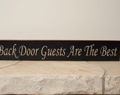 Back Door Guests Are The Best sign