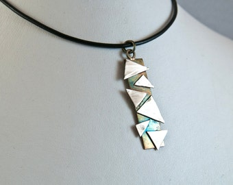 Geometric silver pendant on leather thong