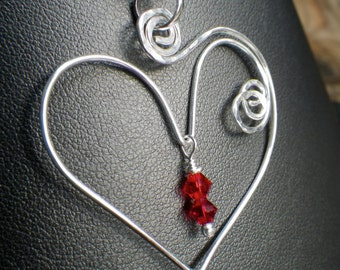 Sterling silver heart with red Swarovski crystals