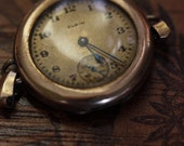 Antique Elgin pocket watch from 1919, 15 jewels, bubble glass front, half Hunter