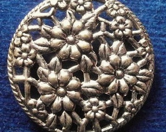 Vintage metal button, filigree with a decorative floral design, c1930's.