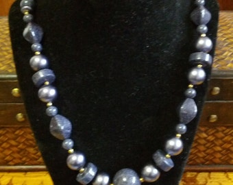 Classic beaded necklace in Slate gray with varying sizes of beads and gold tone metal