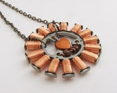 Tesla copper coil necklace with a little heart