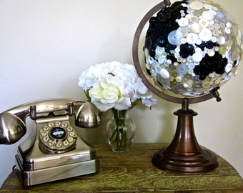 Globe covered in black and white vintage buttons
