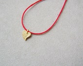 Solid  gold heart necklace, tiny 18K gold  heart on a red cord