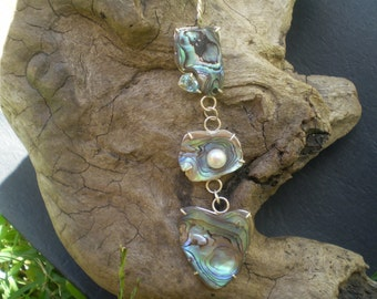 Handmade unique paua shell, freshwater pearl, blue topaz sterling silver pendant.