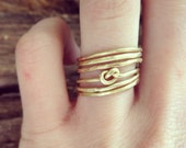 Six Textured Brass and Infinity Knot Stacking Rings