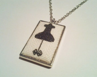 Decorative dress form cross stitch necklace