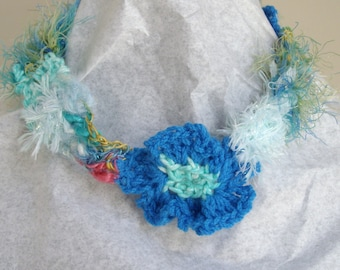 Blue and white crocheted necklace with crocheted flower
