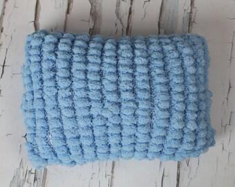 blue pom pom pillow