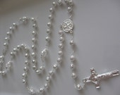crystal rosary to remember first comion, wedding, baptism.