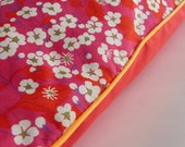 Coussin en Liberty passepoilé orange fluo