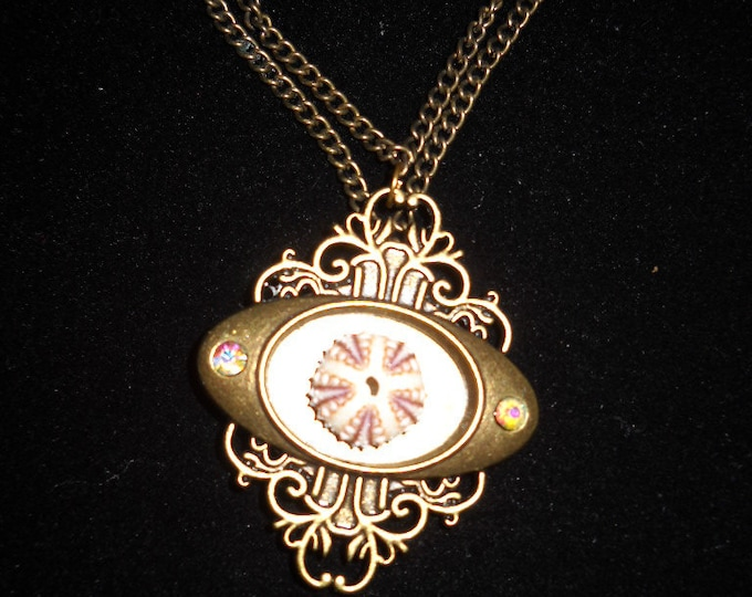 Double Chain (can be used as long single chain) Gold chain and pendant with sea urchin in center.