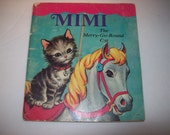 vintage book Mimi the merry-go-round cat/100% animal charity item