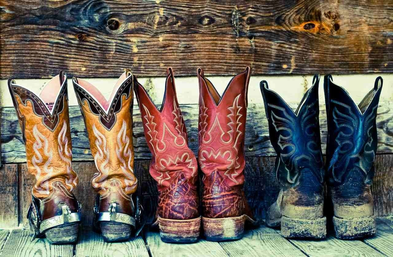 nashville cowboy boots on country home porch kix