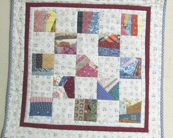 Scrappy patchwork doll quilt, table-topper or wall-hanging