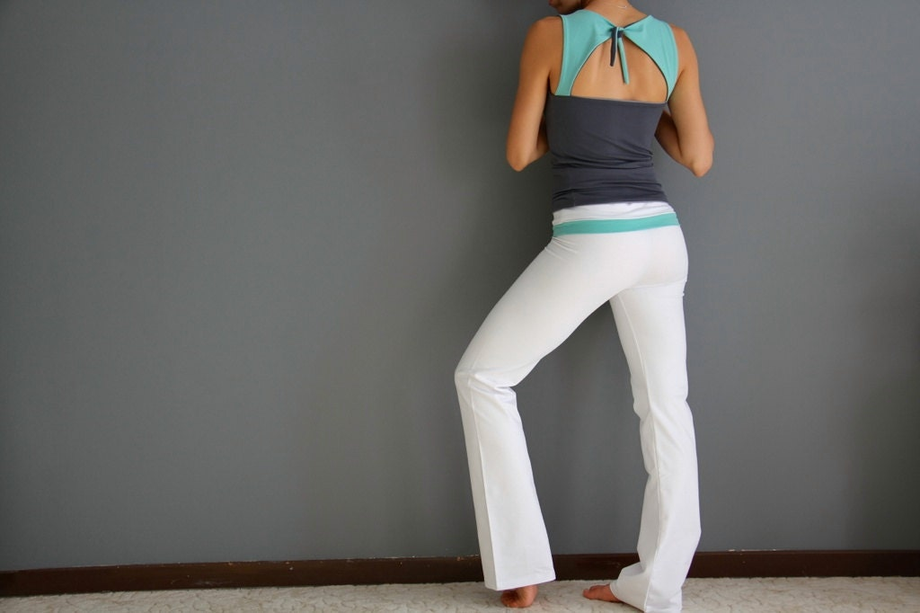 White yoga pants with turquoise belt
